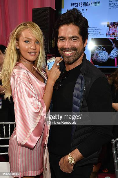 Candice Swanepoel and shoe designer Brian Atwood are seen backstage before the 2015 Victoria's Secret Fashion Show at Lexington Avenue Armory on...