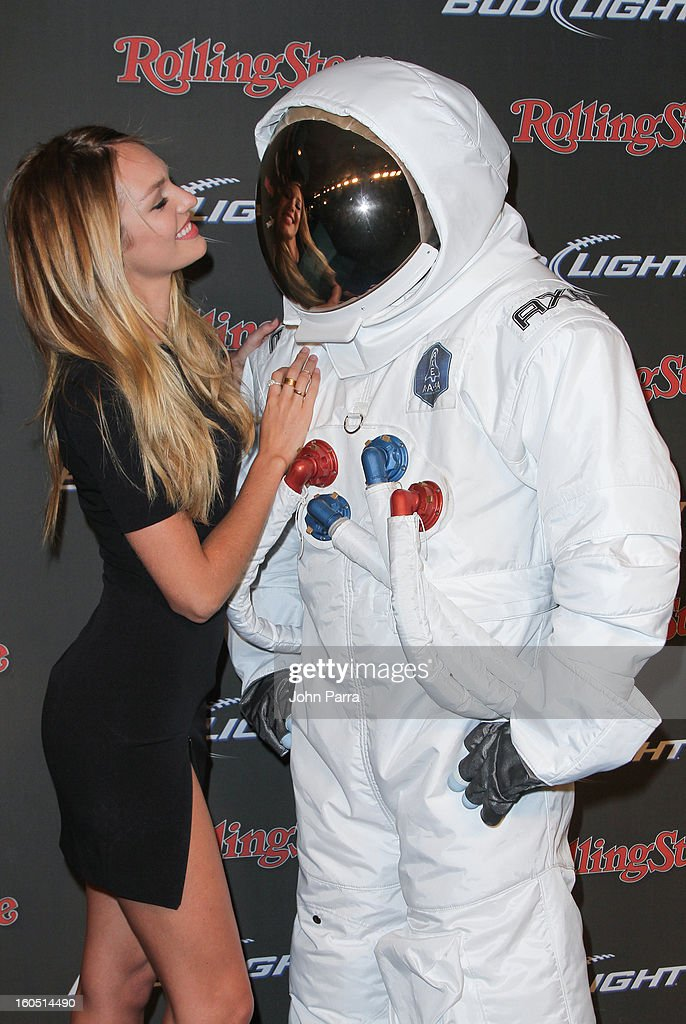 Candice Swanepoel and the AXE Astronaut attend the Rolling Stone party on February 1, 2013 in New Orleans, Louisiana.