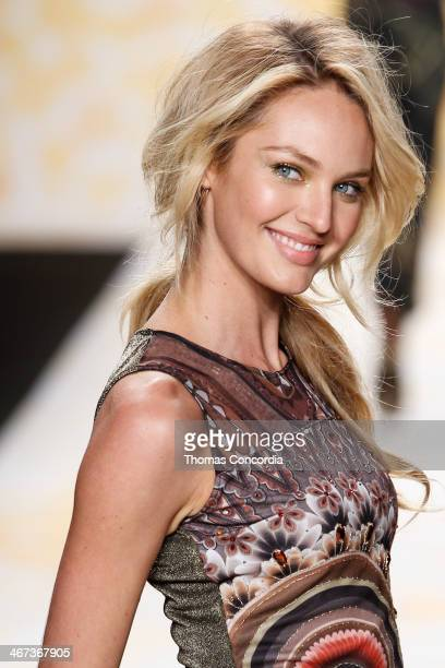 Candice Swanepoel walks the runway at Desigual during MercedesBenz Fashion Week Fall 2014 at The Theatre at Lincoln Center on February 6 2014 in New...