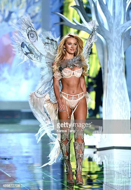 Candice Swanepoel walks the runway at the annual Victoria's Secret fashion show at Earls Court on December 2 2014 in London England