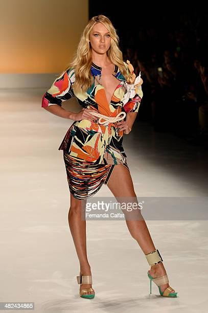 Candice Swanpoel walks the runway during the Forum show at Sao Paulo Fashion Week Summer 2014/2015 at Parque Candido Portinari on April 3 2014 in Sao...