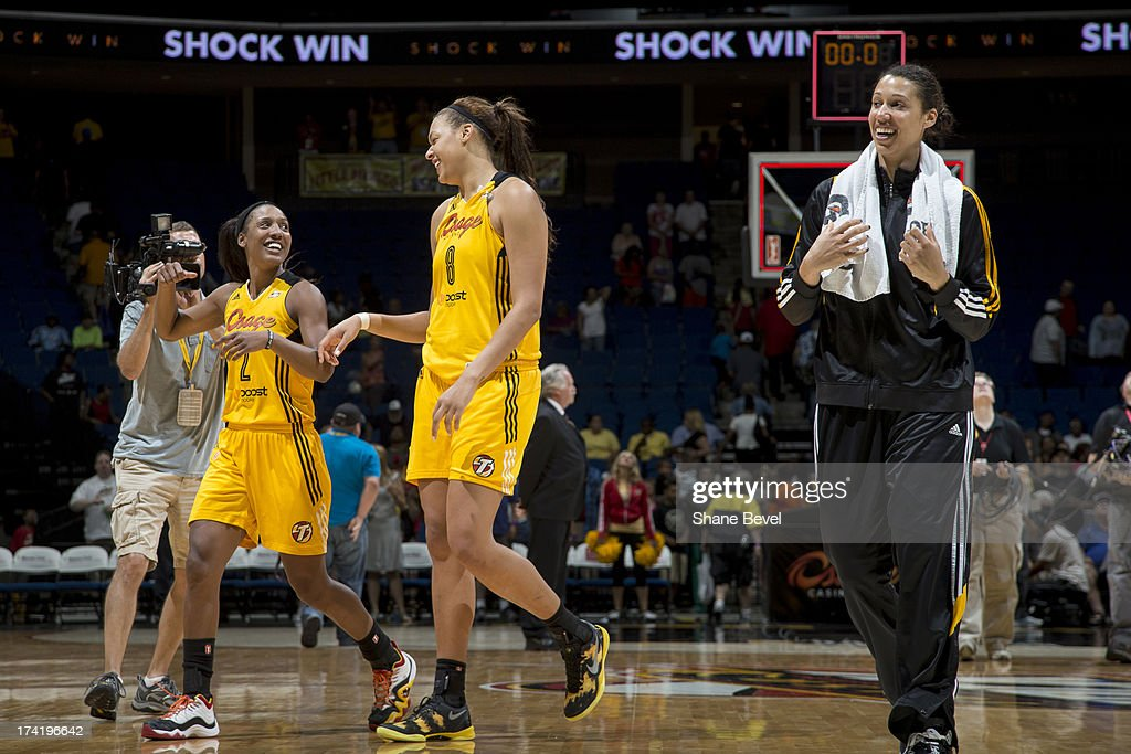 Candice Wiggins #2, Elizabeth Cambage #8 and Nicole Powell #28 of the Tulsa Shock celebrate after defeating the Atlanta Dream in the WNBA game on July 21, 2013 at the BOK Center in Tulsa, Oklahoma.