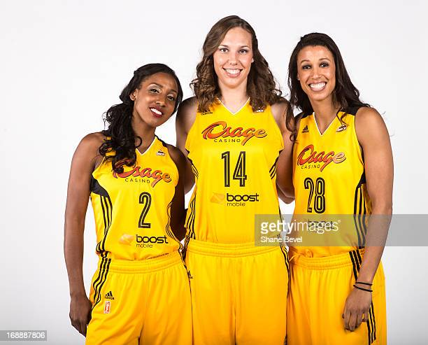 Candice Wiggins Kayla Pedersen and Nicole Powell of the Tulsa Shock pose for a picture during the team media day photo shoot on May 15 2013 at the...