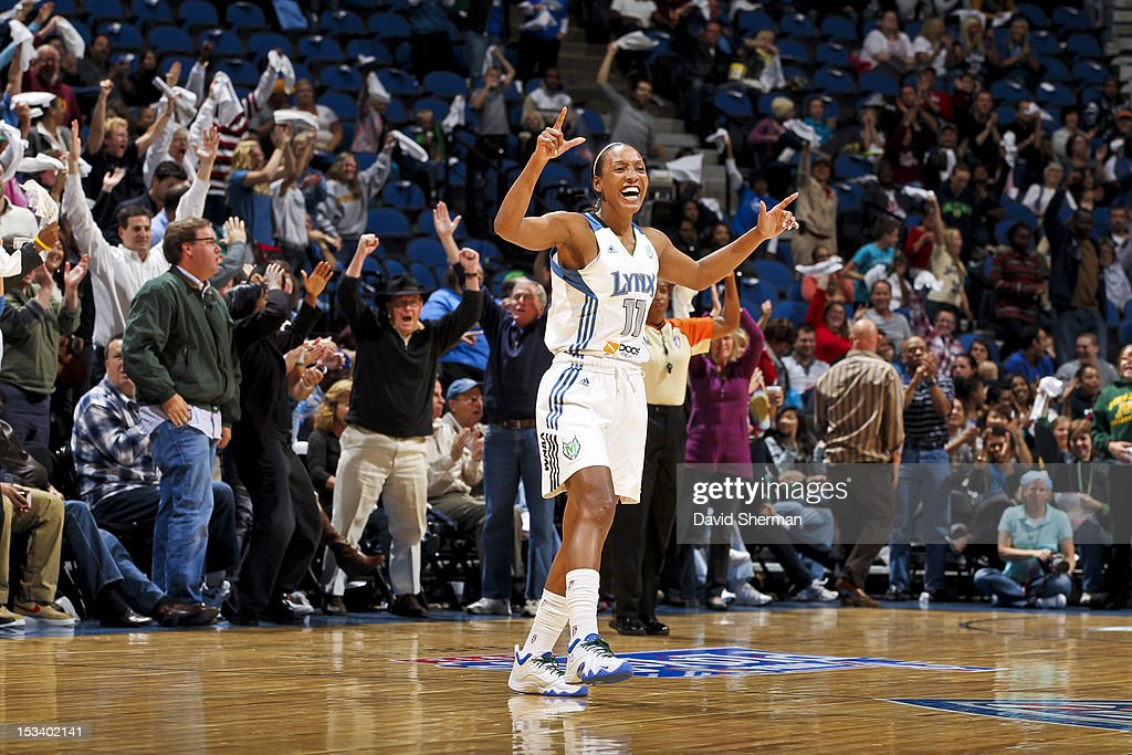 <a gi-track='captionPersonalityLinkClicked' href=/galleries/search?phrase=Candice+Wiggins&family=editorial&specificpeople=2999713 ng-click='$event.stopPropagation()'>Candice Wiggins</a> #11 of the Minnesota Lynx celebrates while playing against the Los Angeles Sparks during Game One of the 2012 WNBA Western Conference Finals on October 4, 2012 at Target Center in Minneapolis, Minnesota.