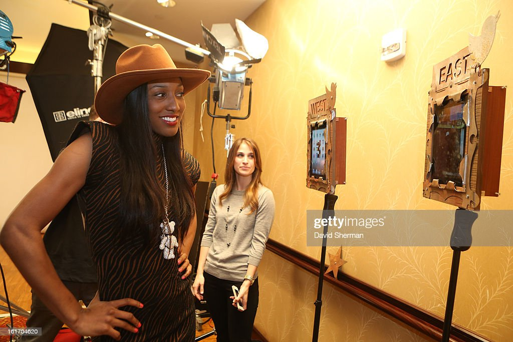 Candice Wiggins of the Minnesota Lynx goes to take some portraits during the NBAE Circuit as part of the 2013 NBA All-Star Weekends at the Hilton Americas Hotel on February 14, 2013 in Houston, Texas.