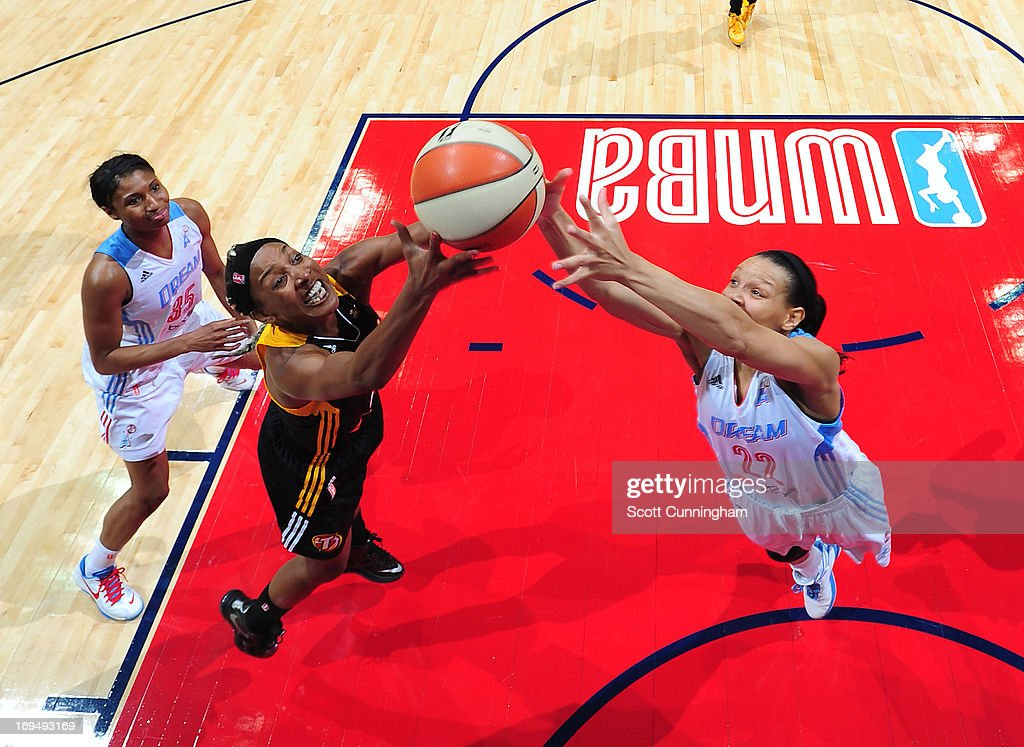 Candice Wiggins #2 of the Tulsa Shock battles for a rebound against Armintie Herrington #22 of the Atlanta Dream at Philips Arena on May 25, 2013 in Atlanta, Georgia.