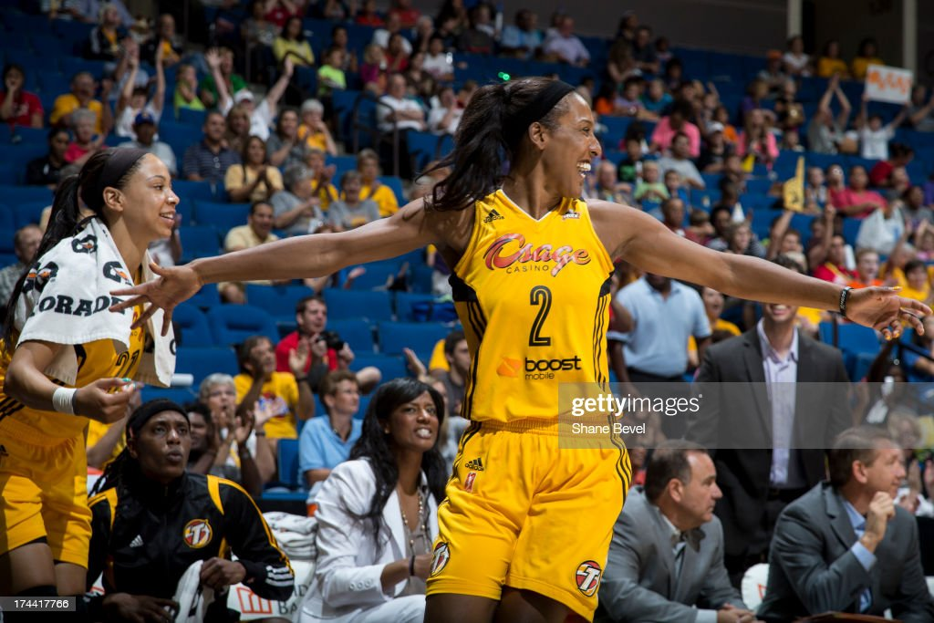 <a gi-track='captionPersonalityLinkClicked' href=/galleries/search?phrase=Candice+Wiggins&family=editorial&specificpeople=2999713 ng-click='$event.stopPropagation()'>Candice Wiggins</a> # 2 of the Tulsa Shock celebrates during the WNBA game against the Indiana Fever on July 25, 2013 at the BOK Center in Tulsa, Oklahoma.
