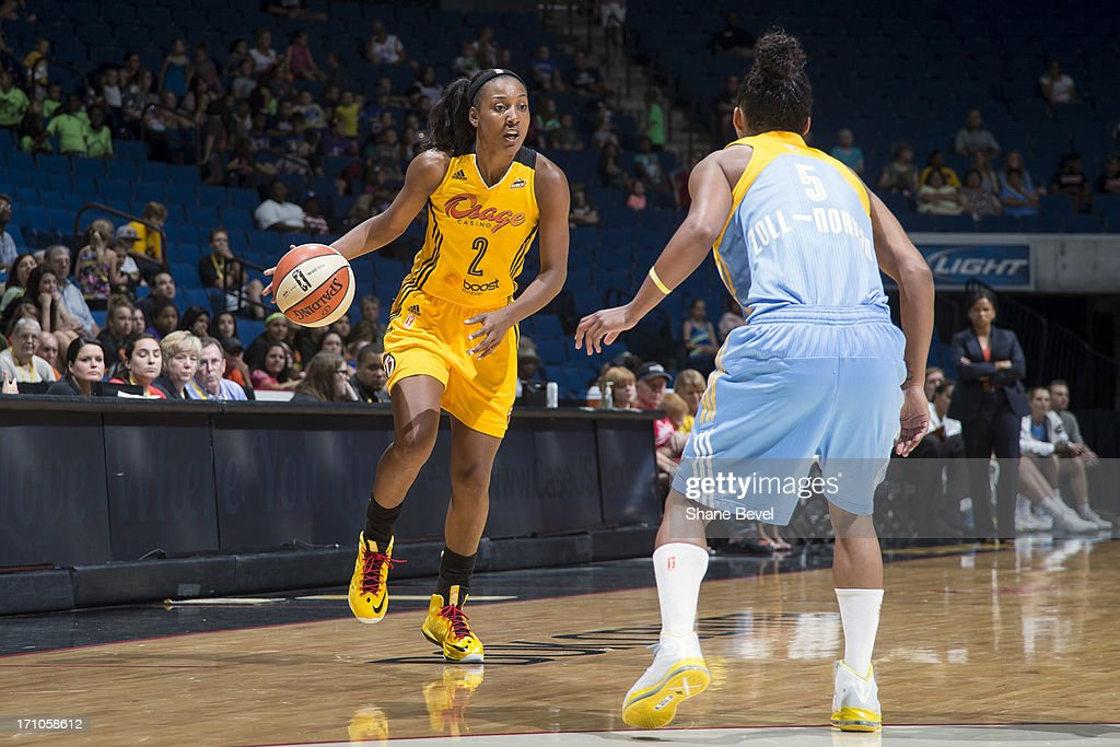 <a gi-track='captionPersonalityLinkClicked' href=/galleries/search?phrase=Candice+Wiggins&family=editorial&specificpeople=2999713 ng-click='$event.stopPropagation()'>Candice Wiggins</a> #2 of the Tulsa Shock dribbles the ball against the Chicago Sky during the WNBA game on June 20, 2013 at the BOK Center in Tulsa, Oklahoma.