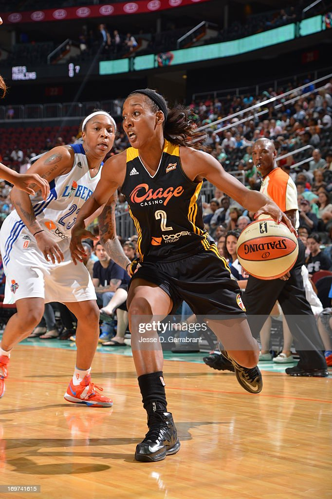 <a gi-track='captionPersonalityLinkClicked' href=/galleries/search?phrase=Candice+Wiggins&family=editorial&specificpeople=2999713 ng-click='$event.stopPropagation()'>Candice Wiggins</a> #2 of the Tulsa Shock drives to the basket against the New York Liberty during the game on May 31, 2013 at Prudential Center in Newark, New Jersey.