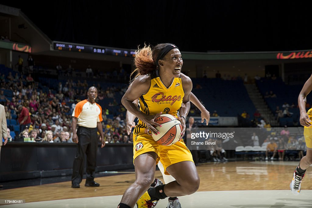 <a gi-track='captionPersonalityLinkClicked' href=/galleries/search?phrase=Candice+Wiggins&family=editorial&specificpeople=2999713 ng-click='$event.stopPropagation()'>Candice Wiggins</a> #2 of the Tulsa Shock drives to the basket during the WNBA game against the San Antonio Silver Stars on August 30, 2013 at the BOK Center in Tulsa, Oklahoma.