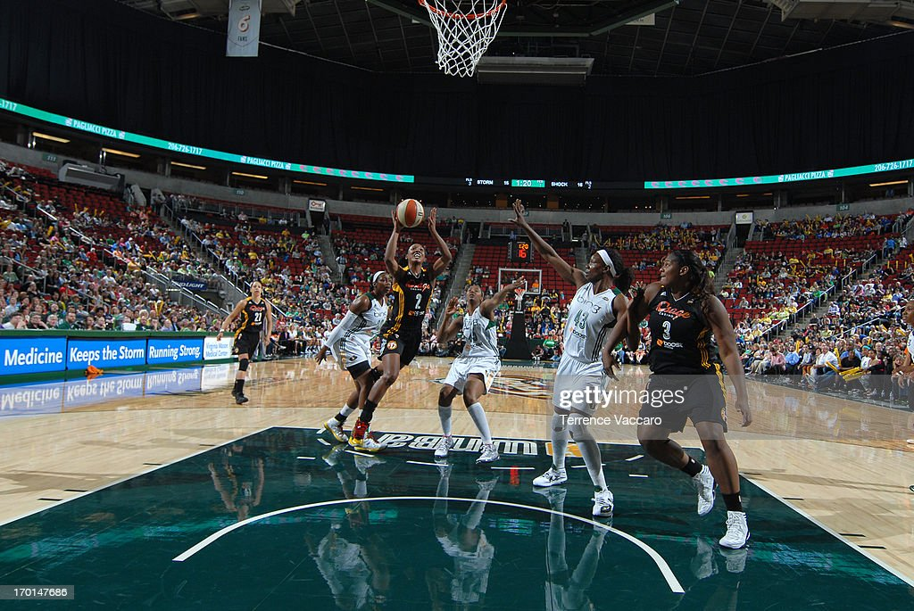 Candice Wiggins of the Tulsa Shock goes to the basket against Nakia Sanford of the Seattle Storm during the WNBA game on June 7 2013 at Key Arena in...
