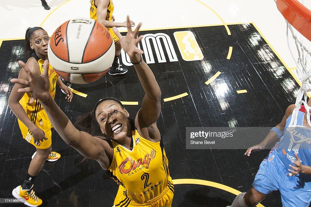 Candice Wiggins #2 of the Tulsa Shock shoots against Erika de Souza #14 of the Atlanta Dream during the WNBA game on July 21, 2013 at the BOK Center in Tulsa, Oklahoma.