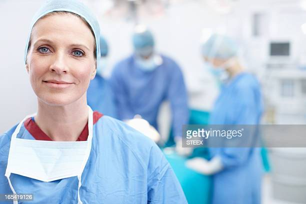 Candid image of an adult doctor in hospital scrubs