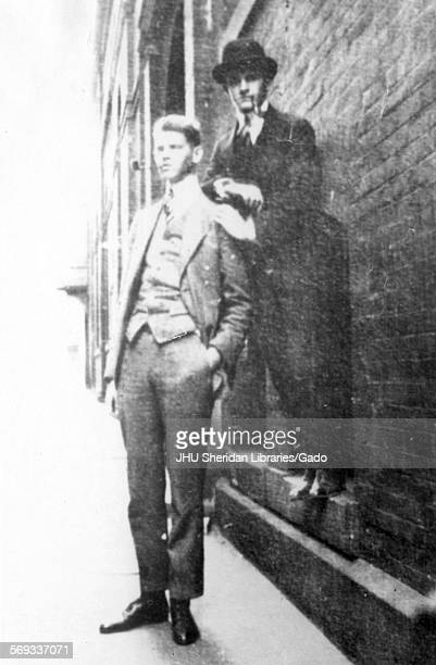 Candid photograph of 18yearolds Richard Slicer Dodson Jr and Howard Chiles Thurman posed at cellar windows of McCoy Hall Old Campus 1914