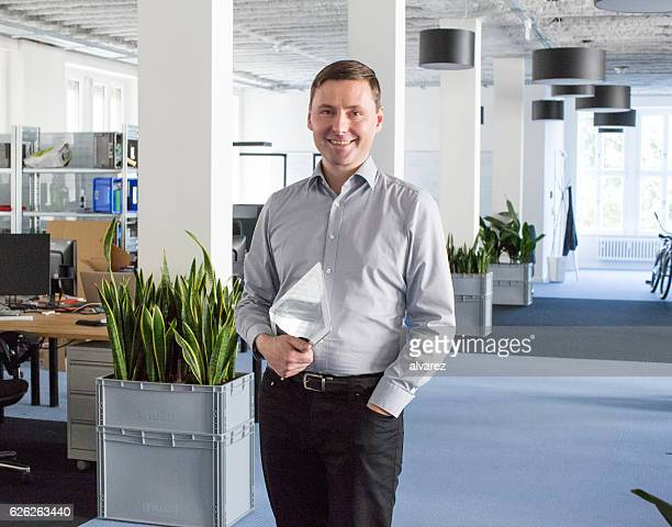 Candid portrait of a business man in an office
