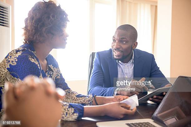 Candid portrait of businessman and woman in meeting room