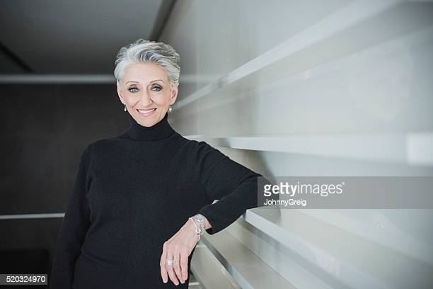 Candid portrait of mature businesswoman in modern office
