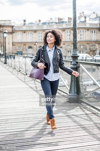 Candid portrait of mixed race woman on wooden path