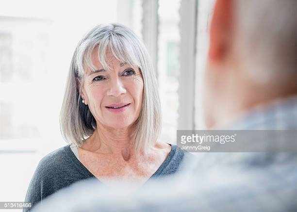 Candid portrait of senior woman with grey bobbed hair