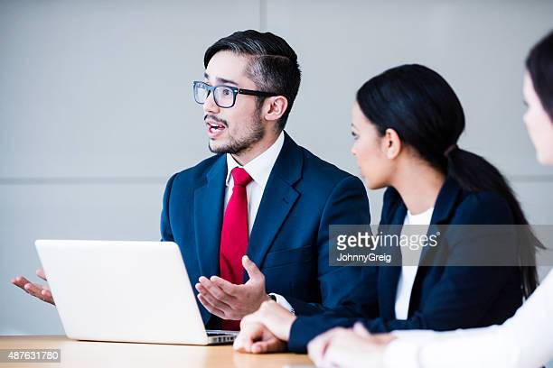 Candid portrait of smart man in business meeting
