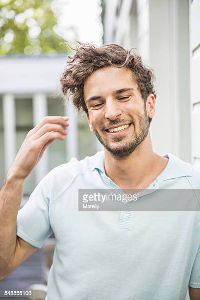 Candid portrait of young man outside house