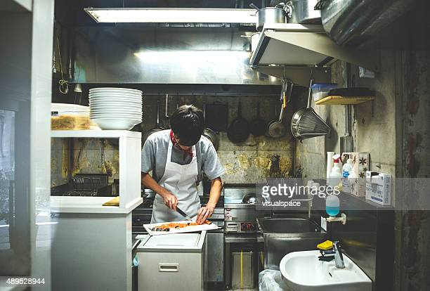 Candid Shot of an Asian Chef Preparing Food