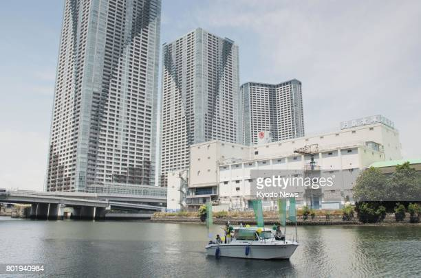 A candidate campaigns from a boat trying to reach out to voters living in highrise buildings in Tokyo's Chuo Ward on June 24 the second day of a...