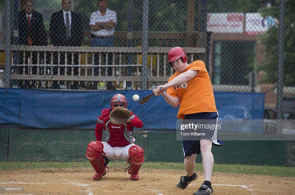 Candidate for Congress Jason Plummer, R-Ill., hits a triple during republican baseball practice at Simpson Stadium in Alexandria, Va.