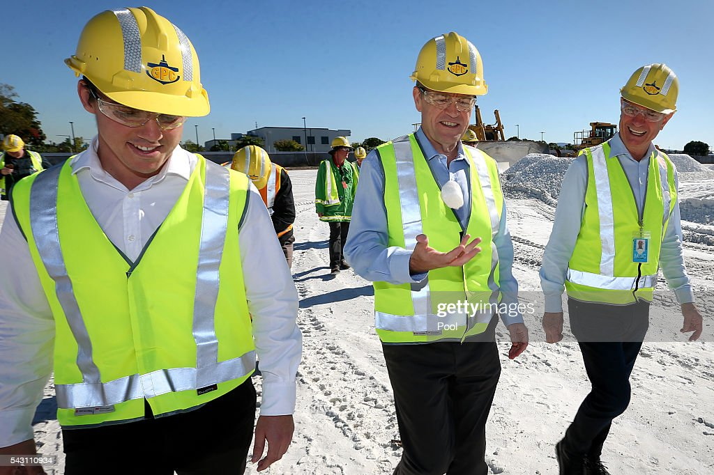 ALP candidate for Flynn, Zac Beers (left), Opposition Leader Bill Shorten looking at calcite (centre) and Chair of Gladstone Ports Corporation Leo Zussino (right) during a visit to the Gladstone Ports Corporation's Auckland Point Terminal, on June 26, 2016 in Gladstone, Queensland. Shorten continues to campaign leading up to the July 2nd elections. (Photo by Alex Ellinghausen-Pool/Getty Images