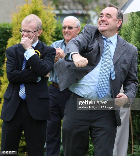 SNP candidate for Glasgow East John Mason with First Minister Alex Salmond who punched the air after a good shot during a game of bowls while...