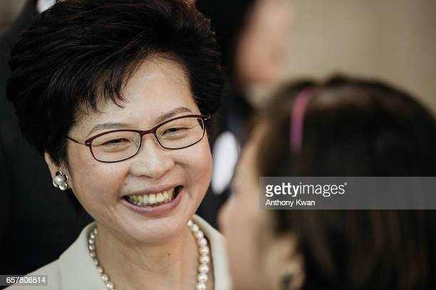 Candidate for Hong Kong's chief executive and former chief secretary Carrie Lam stands outside of a polling station for the chief executive election...