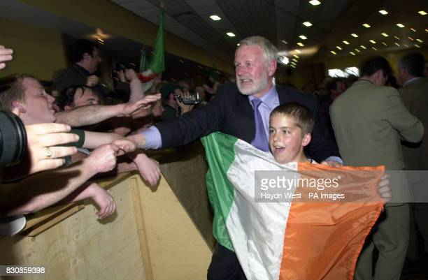 Candidate for North Kerry for Sinn Fein Martin Ferris celebrates victory with 11yearold Sean Lynch holding the Irish flag at the Brandon Hotel in...