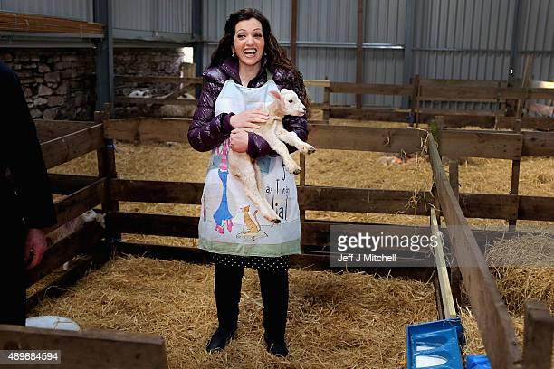SNP candidate for Perthshire South and Ochil Tasmina Ahmed Sheikh holds a lamb as she visits Westhill Farm during canvasing in the constituency on...
