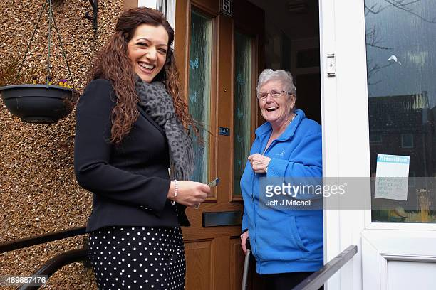 SNP candidate for Perthshire South and Ochil Tasmina Ahmed Sheikh meets a resident as she canvases in the constituency on April 14 2015 in...