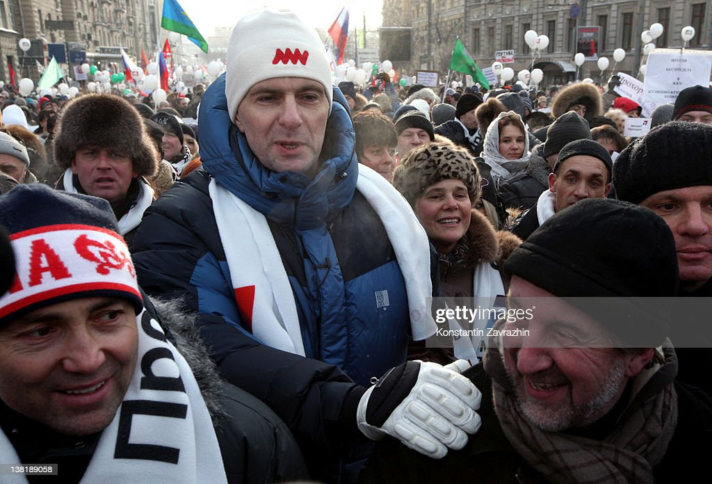 Candidate for Presidential Elections <a gi-track='captionPersonalityLinkClicked' href=/galleries/search?phrase=Mikhail+Prokhorov&family=editorial&specificpeople=4102603 ng-click='$event.stopPropagation()'>Mikhail Prokhorov</a> (C) takes part in a rally and march to Bolotnaya Square on February 4, 2012 in Moscow, Russia. Demonstrators braved temperatures as low as -20 degrees celsius as they took to the streets exactly one month before the presidential elections in protest against Vladimir Putin's efforts to return to the Kremlin for an unprecedented third term as President.