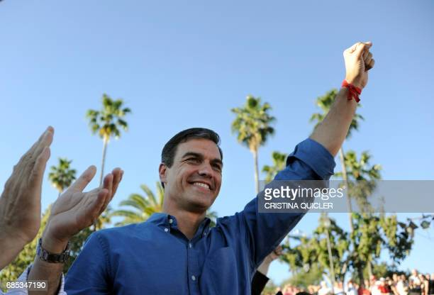 Candidate for Secretary General of the Spanish Socialist Party Pedro Sanchez raises his fist as he takes part in a political meeting at the Muelle de...