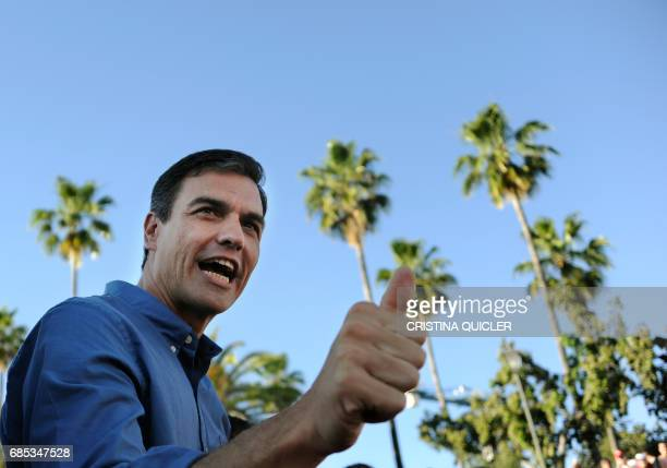 Candidate for Secretary General of the Spanish Socialist Party Pedro Sanchez thumbs up during a political meeting with supporters at the Muelle de la...