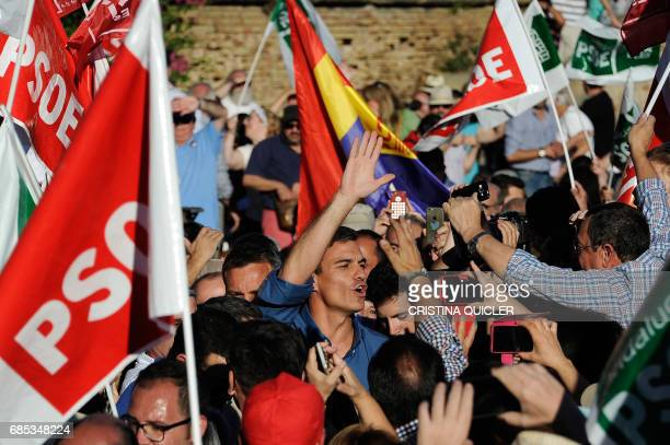 Candidate for Secretary General of the Spanish Socialist Party Pedro Sanchez is acclaimed by supporters as he arrives for a primaries campaign...