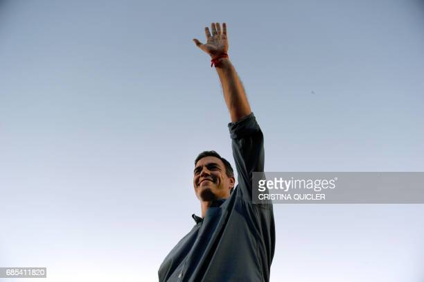 Candidate for Secretary General of the Spanish Socialist Party Pedro Sanchez waves during a political meeting with supporters at the Muelle de la Sal...