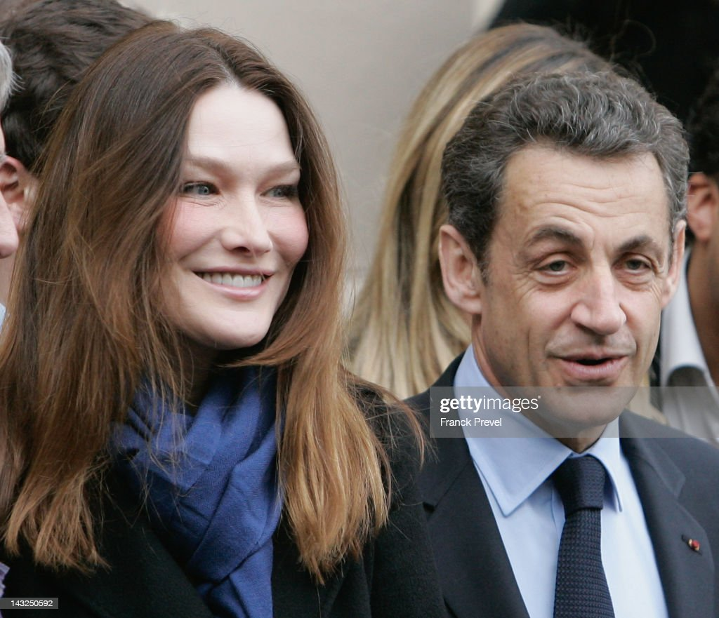Candidate for the 2012 French presidential election Nicolas Sarkozy and wife Carla BruniSarkozy appear after voting at Lycee Jean De La Fontaine on...