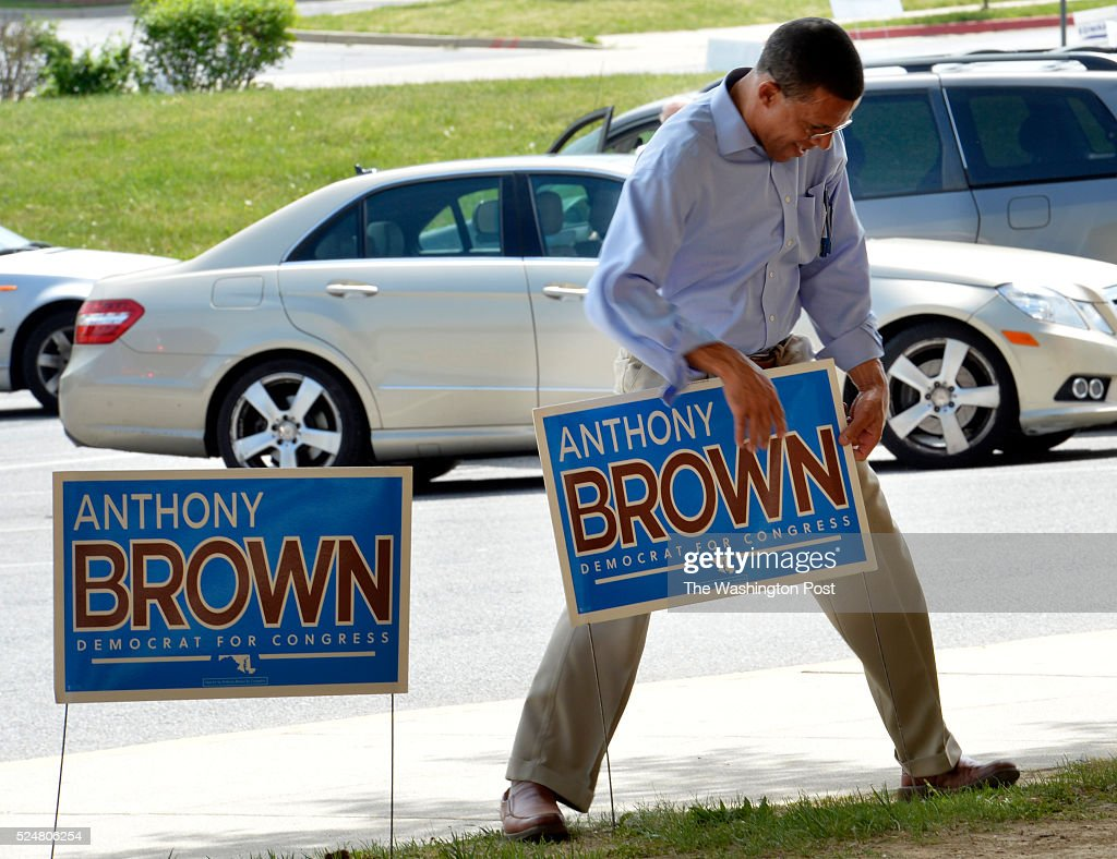 Candidate for the 4th Congressional District Anthony G. Brown making adjustments to one of his signs outside of the Charles Herbert Flowers high school on April 26, 2016 in Springdale, Md.