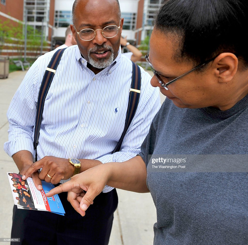 Candidate for the 4th Congressional District Glenn F. Ivey talked with Carol Chin outside of the Charles Herbert Flowers high school on April 26, 2016 in Springdale, Md.