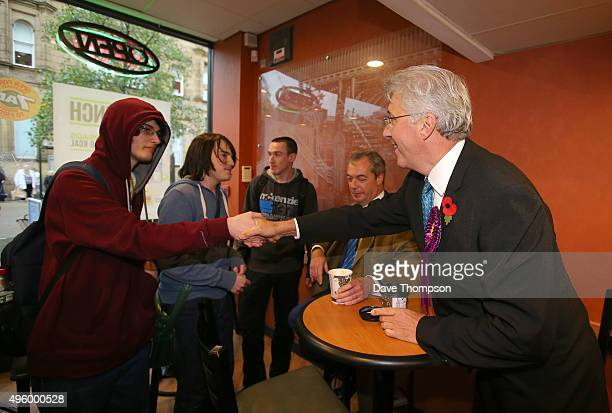 UKIP candidate for the Oldham byelection John Bickley and party leader Nigel Farage meet local students before the byelection next month on November...