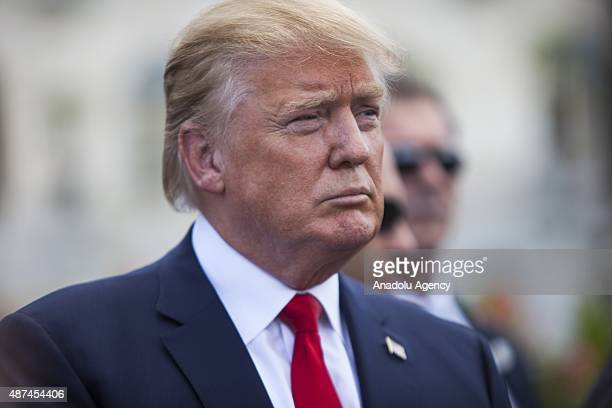 Candidate for the Republican Presidential nomination Donald Trump waits to speak at a rally held by the Tea Party at the United States Capitol to...