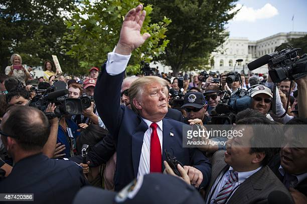 Candidate for the Republican Presidential nominee Donald Trump waives to supporters after speaking at a rally held by the Tea Party at the United...