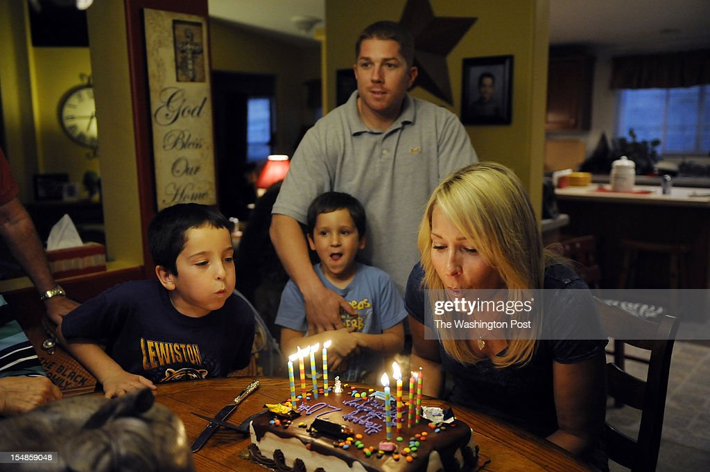 Candidate for the U.S. House of Representatives, Jimmy Farris, top center, embraces his newphew, Cade Hill, 6, as Cade's brother, Blake Hill, 8, left, helps their mother and Jimmy's sister, Lainey Hill, right, blow out candles during an early birthday celebration for her at the Hill family home on Sunday September 23, 2012 in Lewiston, ID. Jimmy is a former professional football player, who played with the Washington Redskins among other teams. He was a member of the New England Patriots when they won Super Bowl XXXVI. He grew up in Lewiston, ID.