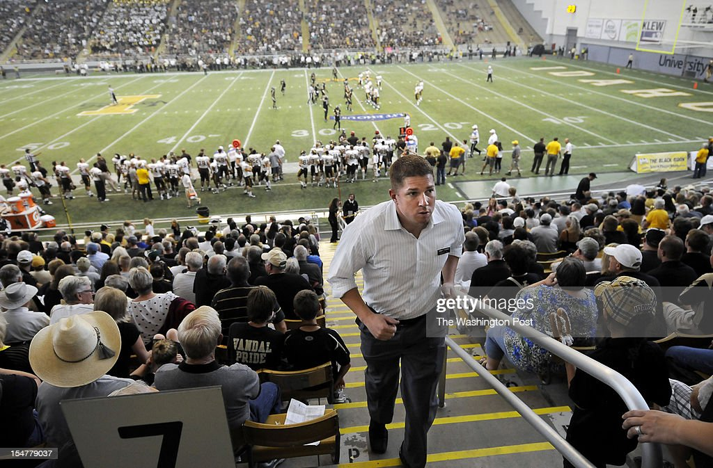 Candidate for the U.S. House of Representatives, Jimmy Farris walks up stairs while at a University of Idaho football game in the Kibbie Dome as he campaigned at the university in Moscow, ID on Saturday September 22, 2012. Jimmy is a former professional football player, who played with the Washington Redskins among other teams. He was a member of the New England Patriots when they won Super Bowl XXXVI. He grew up in Lewiston, ID.