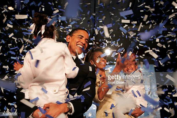 Candidate for the US Senate Barack Obama and his daughter Malia wife Michelle and youngest daughter Sasha celebrate his victory with supporters over...