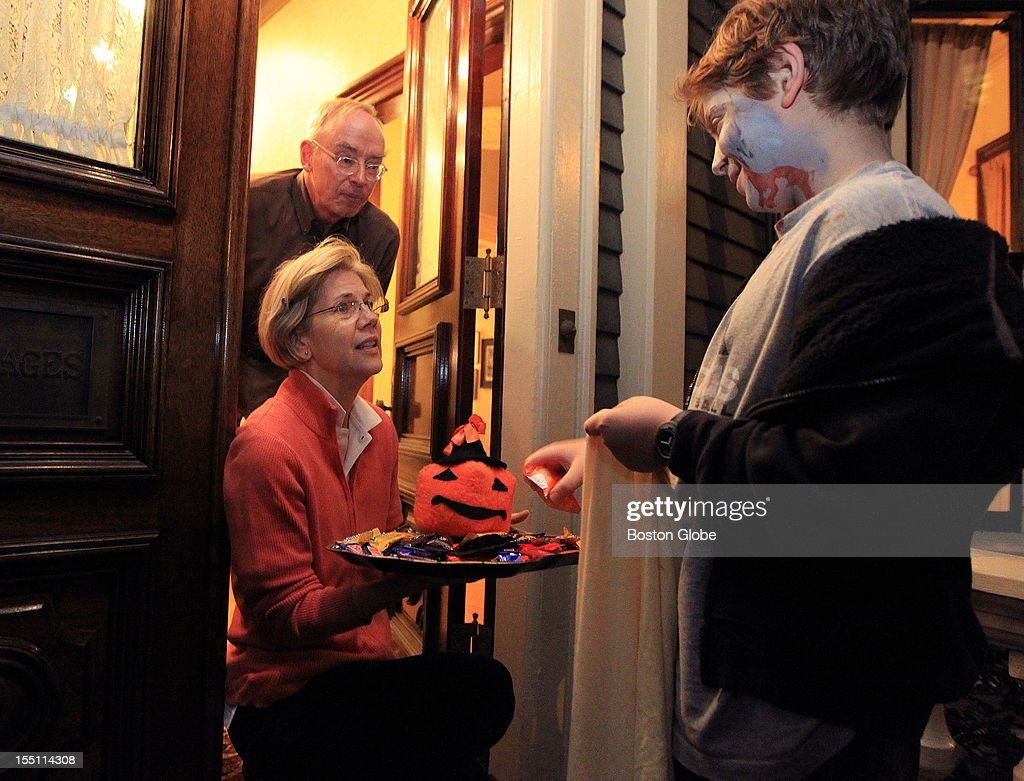Candidate for U.S. Senate Elizabeth Warren and husband Bruce hand out candy to trick-or-treaters at their Cambridge home on Halloween.