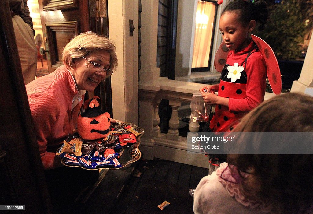Candidate for U.S. Senate Elizabeth Warren hands out candy to trick-or-treaters at her Cambridge home on Halloween.